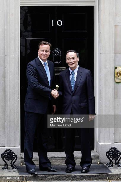 Prime Minister David Cameron and Chinese Vice President Wang Qishan shake hands outside Number 10 Downing Street on September 8 2011 in London...