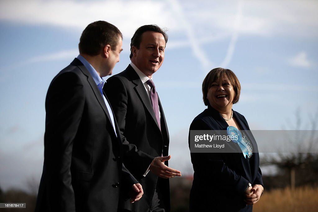 Prime Minister <a gi-track='captionPersonalityLinkClicked' href=/galleries/search?phrase=David+Cameron+-+Politician&family=editorial&specificpeople=227076 ng-click='$event.stopPropagation()'>David Cameron</a> and Conservative candidate <a gi-track='captionPersonalityLinkClicked' href=/galleries/search?phrase=Maria+Hutchings&family=editorial&specificpeople=2542017 ng-click='$event.stopPropagation()'>Maria Hutchings</a> are welcomed at B&Q house for a Cameron Direct session on February 14, 2013 in Eastleigh, Hampshire. A by-election has been called in the constituency of Eastleigh after its former MP, Chris Huhne, resigned after pleading guilty to perverting the course of justice over claims his ex-wife took speeding points for him in 2003.