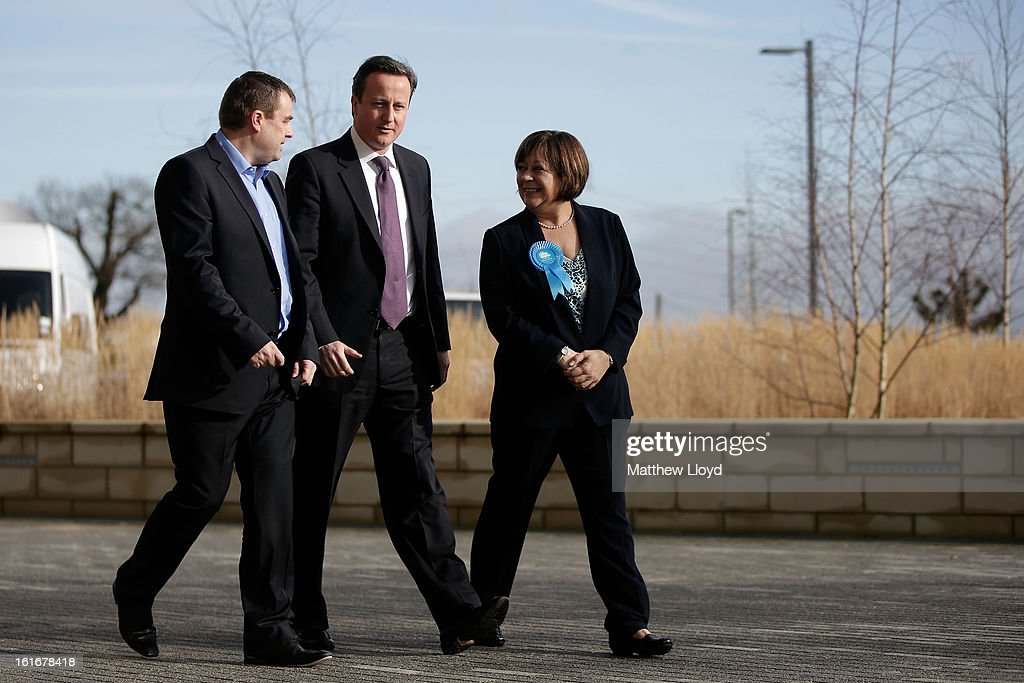 Prime Minister <a gi-track='captionPersonalityLinkClicked' href=/galleries/search?phrase=David+Cameron+-+Politician&family=editorial&specificpeople=227076 ng-click='$event.stopPropagation()'>David Cameron</a> and Conservative candidate Maria Hutchings are welcomed at B&Q house for a Cameron Direct session on February 14, 2013 in Eastleigh, Hampshire. A by-election has been called in the constituency of Eastleigh after its former MP, Chris Huhne, resigned after pleading guilty to perverting the course of justice over claims his ex-wife took speeding points for him in 2003.