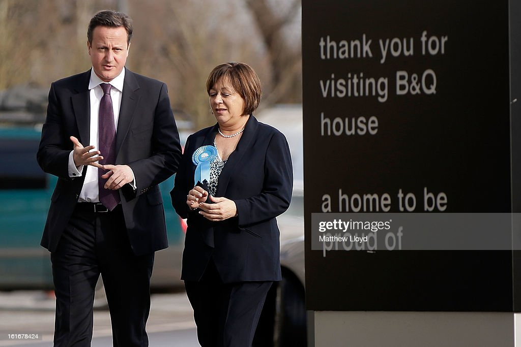 Prime Minister <a gi-track='captionPersonalityLinkClicked' href=/galleries/search?phrase=David+Cameron+-+Politician&family=editorial&specificpeople=227076 ng-click='$event.stopPropagation()'>David Cameron</a> and Conservative candidate Maria Hutchings arrive at B&Q house for a Cameron Direct session on February 14, 2013 in Eastleigh, Hampshire. A by-election has been called in the constituency of Eastleigh after its former MP, Chris Huhne, resigned after pleading guilty to perverting the course of justice over claims his ex-wife took speeding points for him in 2003.