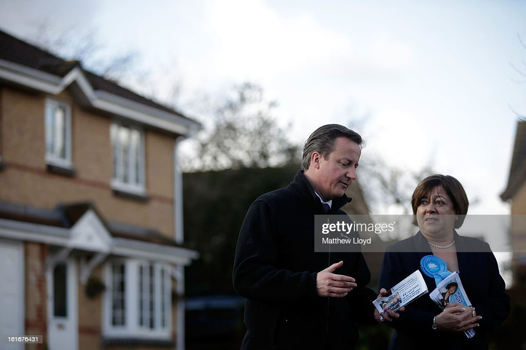 Prime Minister <a gi-track='captionPersonalityLinkClicked' href=/galleries/search?phrase=David+Cameron+-+Politician&family=editorial&specificpeople=227076 ng-click='$event.stopPropagation()'>David Cameron</a> and Conservative candidate Maria Hutchings leaflet drop residential homes, before the imminent by-election, on February 14, 2013 in Eastleigh, Hampshire. The by-election has been called as its former MP, Chris Huhne, resigned after pleading guilty to perverting the course of justice over claims his ex-wife took speeding points for him in 2003.