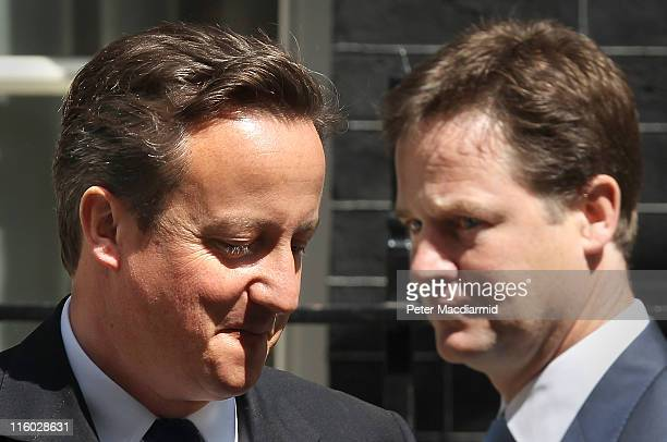 Prime Minister David Cameron and Deputy Prime Minister Nick Clegg pass each other in Downing Street on June 14 2011 in London England The Prime...