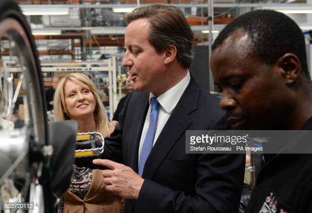 Prime Minister David Cameron and Employment Minister Esther McVey meet employees and see the production line of Brompton Bicycles Ltd in Brentford...