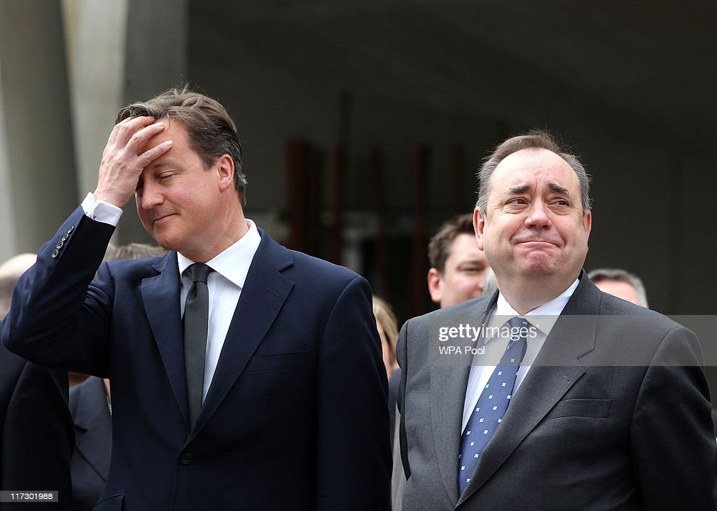Prime Minister David Cameron (L) and First Minister Alex Salmond attend the Drumhead Service on June 25, 2011 in Edinburgh, Scotland. Prince Charles and Duchess, Camilla took the salute from the march past of 2,000 serving personnel, veterans and cadets as they marched down the Royal Mile from the Castle Esplanade to Holyrood Park on Armed Forces Day.