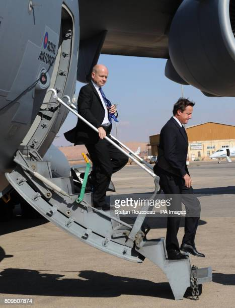 Prime Minister David Cameron and Foreign Secretary William Hague arrive at Tripoli Airport during a one day visit to Libya with French President...
