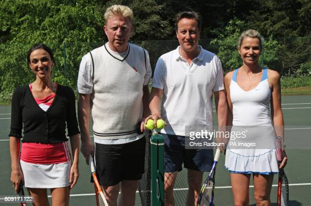 Prime Minister David Cameron and former Wimbledon champion Boris Becker with charity auction winners Caroline Wynn and Sharon Kettle before a charity...