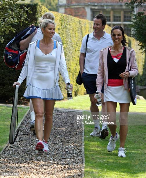 Prime Minister David Cameron and former Wimbledon champion Boris Becker walk out with charity auction winners Caroline Wynn and Sharon Kettle before...