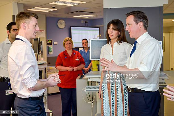 Prime Minister David Cameron and his wife Samantha Cameron talk to Urology Clinical Director Mr David Shackley during a visit to the Salford Royal...