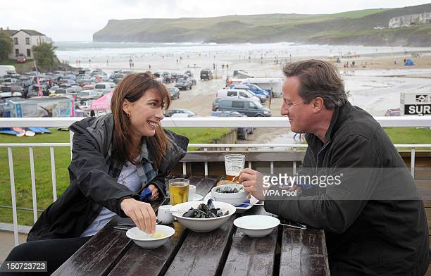 Prime Minister David Cameron and his wife Samantha have lunch at Polzeath during their summer holiday in North Cornwall on August 25 2012 in Polzeath...