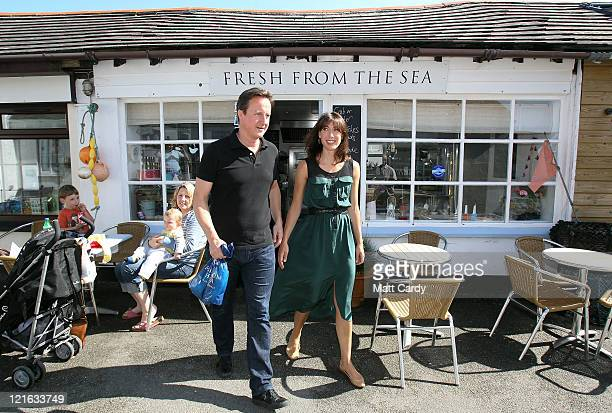 Prime Minister David Cameron and his wife Samantha leave the fish shop 'Fresh From The Sea' on August 21 2011 in Port Isaac England The Cameron...
