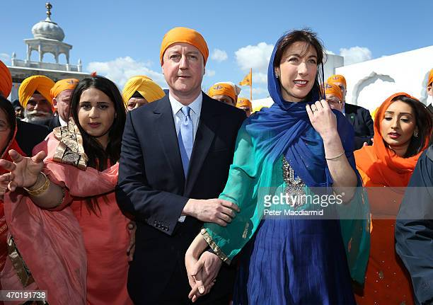 Prime Minister David Cameron and his wife Samantha take part the Vaisakhi Nagar Kirtan procession at Guru Nanak Darbar Gurdwara on April 18 2015 in...
