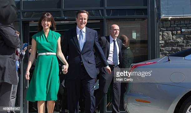 Prime Minister David Cameron and his wife Samantha walk to their car following a rally to unveil the Conservative party manifesto on April 14 2015 in...