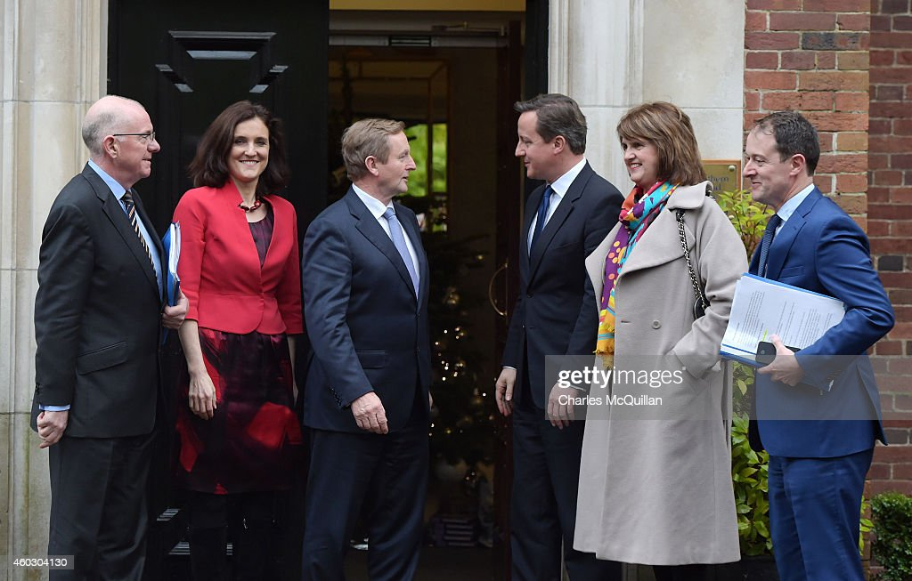 Prime Minister <a gi-track='captionPersonalityLinkClicked' href=/galleries/search?phrase=David+Cameron+-+Politician&family=editorial&specificpeople=227076 ng-click='$event.stopPropagation()'>David Cameron</a> (3rd R) and Irish Taoiseach <a gi-track='captionPersonalityLinkClicked' href=/galleries/search?phrase=Enda+Kenny&family=editorial&specificpeople=5129605 ng-click='$event.stopPropagation()'>Enda Kenny</a> (3rd L) alongside Northern Ireland Secretary of State Theresa Villiers (2nd R) and Irish Tanaiste Joan Burton (2nd R) arrive for cross party talks at Stormont on December 11, 2014 in Belfast, Northern Ireland. During the cross-party talks it is hoped that a number of issues can be resolved, including welfare reform and the legacy left by the country's troubled past.