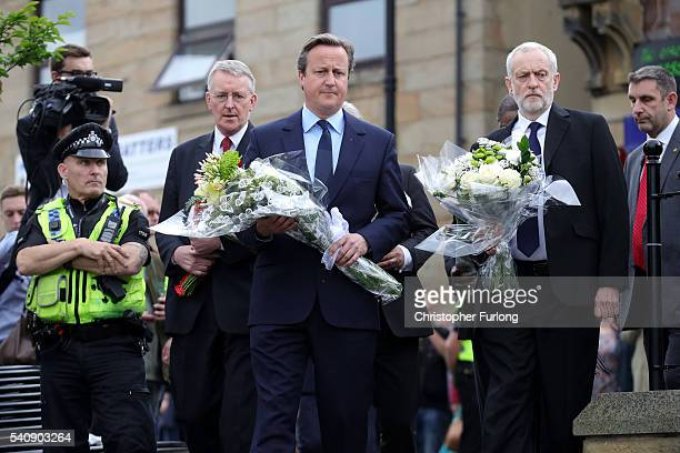 Prime Minister David Cameron and Labour Leader Jeremy Corbyn arrive to pay their respects at the scene of the murder of Jo Cox Labour MP for Batley...