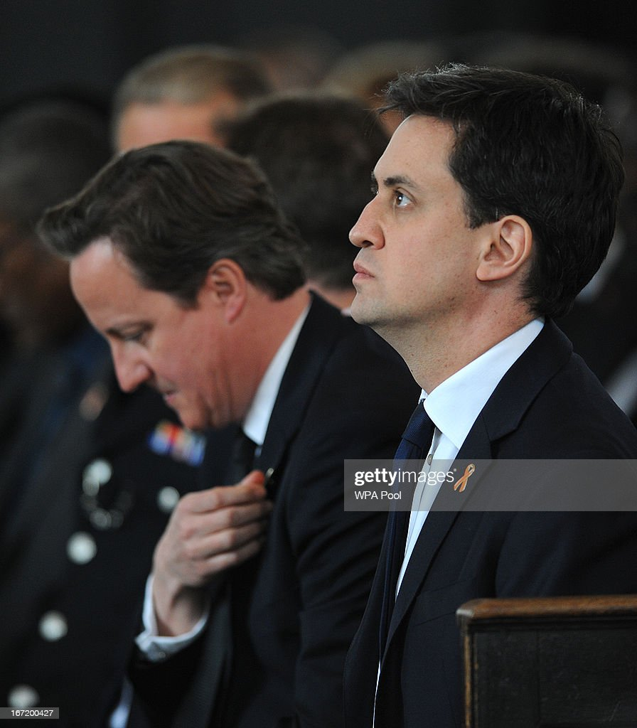 Prime Minister David Cameron (L) and Labour Party Leader Ed Miliband attend a memorial service for Stephen Lawrence at St Martin-in-the-Fields Church on April 22, 2013 in London, England. Stephen Lawrence, a black A-level student was stabbed to death at a bus stop twenty years ago by a gang of white youths in a racially motivated attack in Eltham, south-east London, on April 22, 1993. Two men, Gary Dobson and David Norris were found guilty of his murder in January 2012.