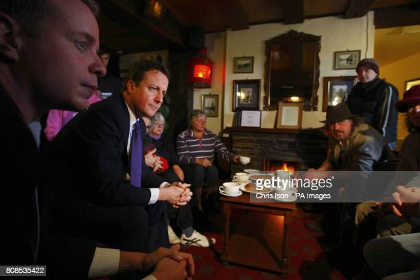 Prime Minister David Cameron and local MP Stephen Gilbert meet residents of Pentewan at The Ship Inn during a visit to St Austell in Cornwall to see...