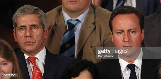 Prime Minister David Cameron and Marks and Spencer Chairman Sir Stuart Rose listen as Chancellor of the Exchequer George Osborne speaks at the...