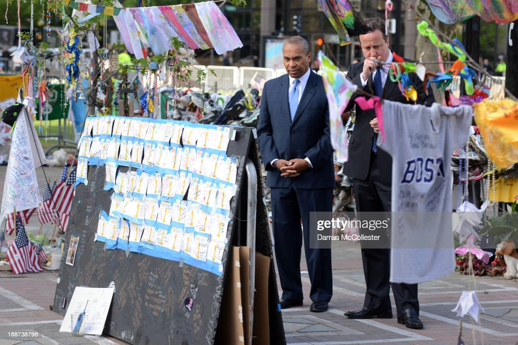 Prime Minister David Cameron and Massachusetts Governor Deval Patrick visit the memorial to the Boston Marathon bombing victims on Boylston Street on...
