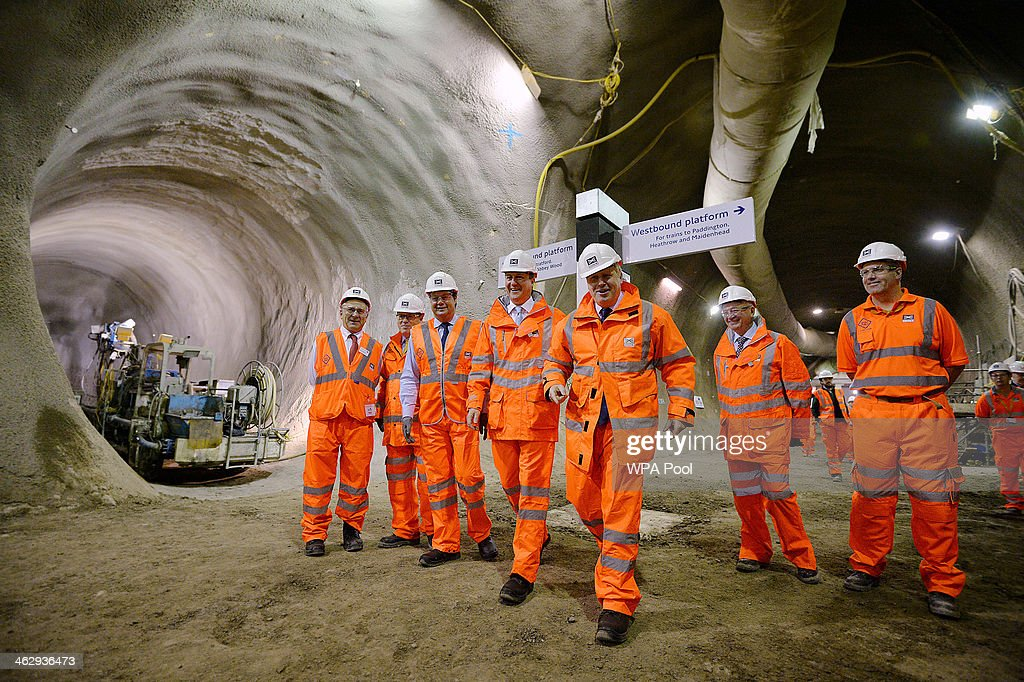 Prime Minister David Cameron (CL) and Mayor of London Boris Johnson (CR) visit a Crossrail construction site underneath Tottenham Court Road, on January 16, 2014 in central London, England. The Crossrail project, which is expected to be completed in 2018, will link Berkshire, west of London with Essex, east of London.