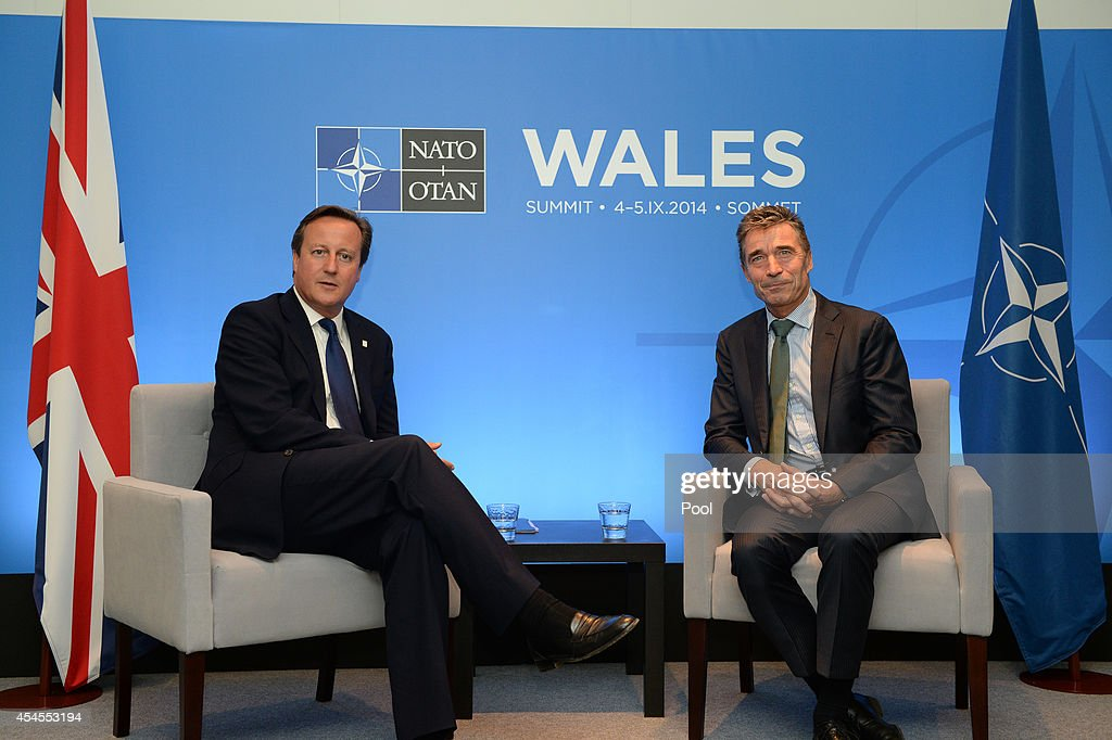 Prime Minister David Cameron (L) and NATO Secretary General Anders Fogh Rasmussen (R) talk on the eve of the NATO Summit 2014 at the Celtic Manor Resort on September 3, 2014 in Newport, Wales. Final preperations are being made in both Cardiff and Newport where the summit is being hosted at the Celtic Manor Resort.
