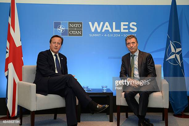 Prime Minister David Cameron and NATO Secretary General Anders Fogh Rasmussen talk on the eve of the NATO Summit 2014 at the Celtic Manor Resort on...