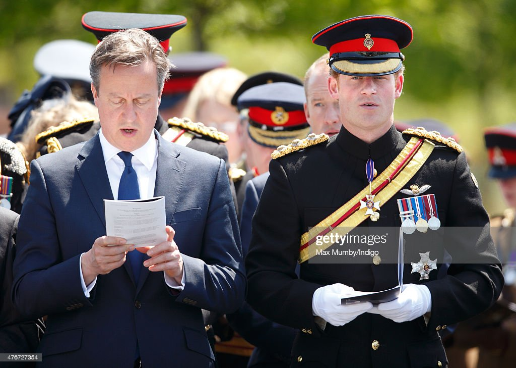 Prime Minister David Cameron and Prince Harry attend a Service of Dedication to inaugurate the Bastion Memorial at the National Memorial Arboretum on June 11, 2015 in Stafford, England.