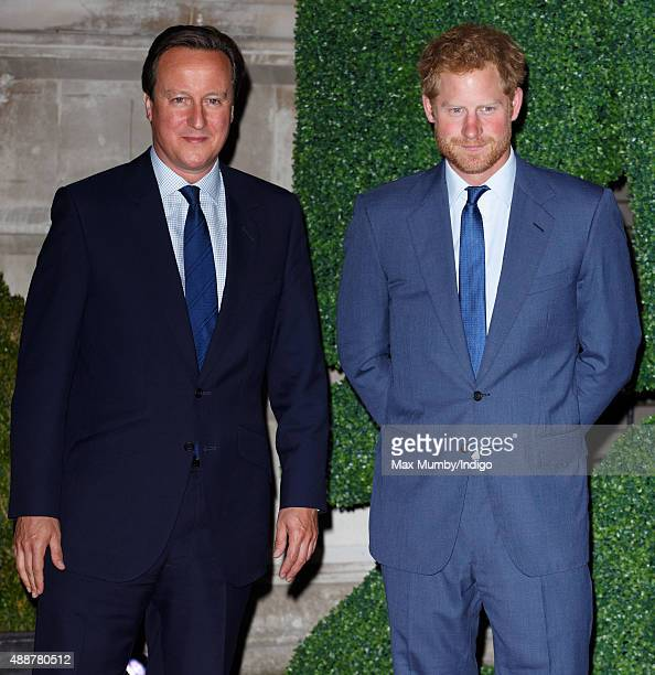 Prime Minister David Cameron and Prince Harry attend the Rugby World Cup 2015 welcome party at The Foreign Office on September 17 2015 in London...