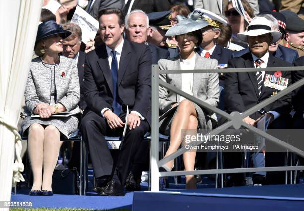 Prime Minister David Cameron and Samantha Cameron talk with other dignitaries before the Service of Remembrance at the Commonwealth War Graves...