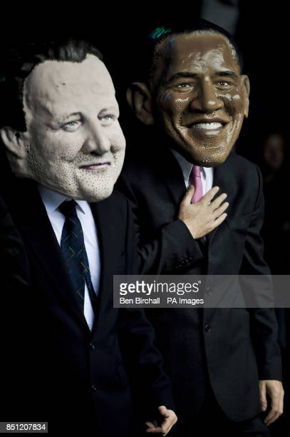 UK Prime Minister David Cameron and the President of the United States Barack Obama are impersonated as the large headed G8 politicians arrive...