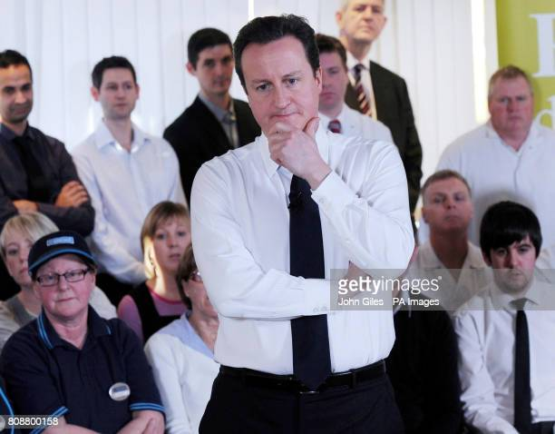 Prime Minister David Cameron answers questions from workers at the Greggs HQ in Newcastle