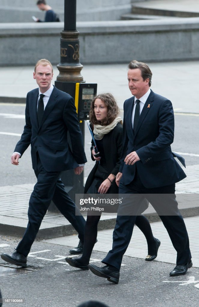 Prime Minister David Cameron (R) arrives to attend a memorial service for Stephen Lawrence at St Martin-in-the-Fields Church on April 22, 2013 in London, England. Stephen Lawrence, a black A-level student was stabbed to death at a bus stop twenty years ago by a gang of white youths in a racially motivated attack in Eltham, south-east London, on April 22, 1993. Two men, Gary Dobson and David Norris were found guilty of his murder in January 2012.