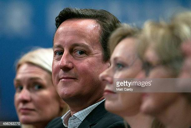 Prime Minister David Cameron arrives to listen to Leader of the House of Commons William Hague address delegates at the Conservative party conference...