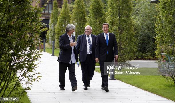 Prime Minister David Cameron arrives with Eric Pickles and Phil Redmond to give a Big Society speech at the Cornerstone Building Liverpool Hope...