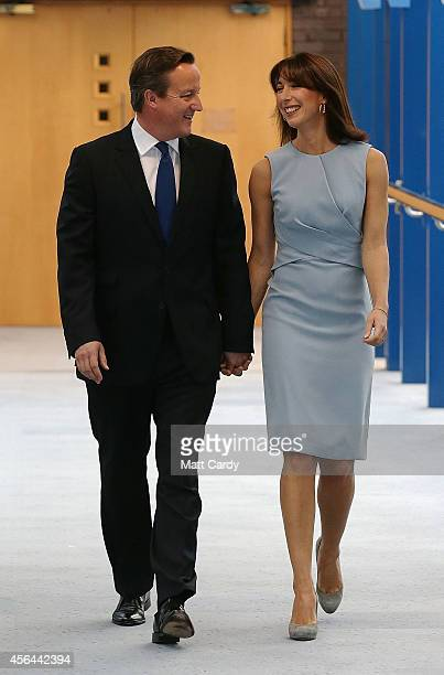 Prime Minister David Cameron arrives with wife Samantha to deliver his keynote speech at the Conservative Party Conference in the main hall of the...