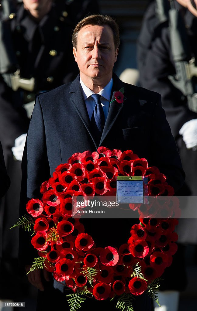 Prime Minister <a gi-track='captionPersonalityLinkClicked' href=/galleries/search?phrase=David+Cameron+-+Politician&family=editorial&specificpeople=227076 ng-click='$event.stopPropagation()'>David Cameron</a> attends Remembrance Sunday at the Cenotaph on Whitehall on November 10, 2013 in London, England.