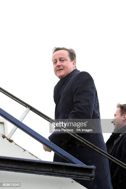 Prime Minister David Cameron boards a British Airways flight to Zurich at Heathrow Airport London