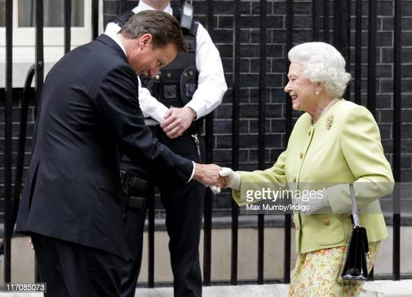 Prime Minister David Cameron bows whilst greeting Queen Elizabeth II as she arrives for a lunch to celebrate the Duke of Edinburgh's 90th birthday at...