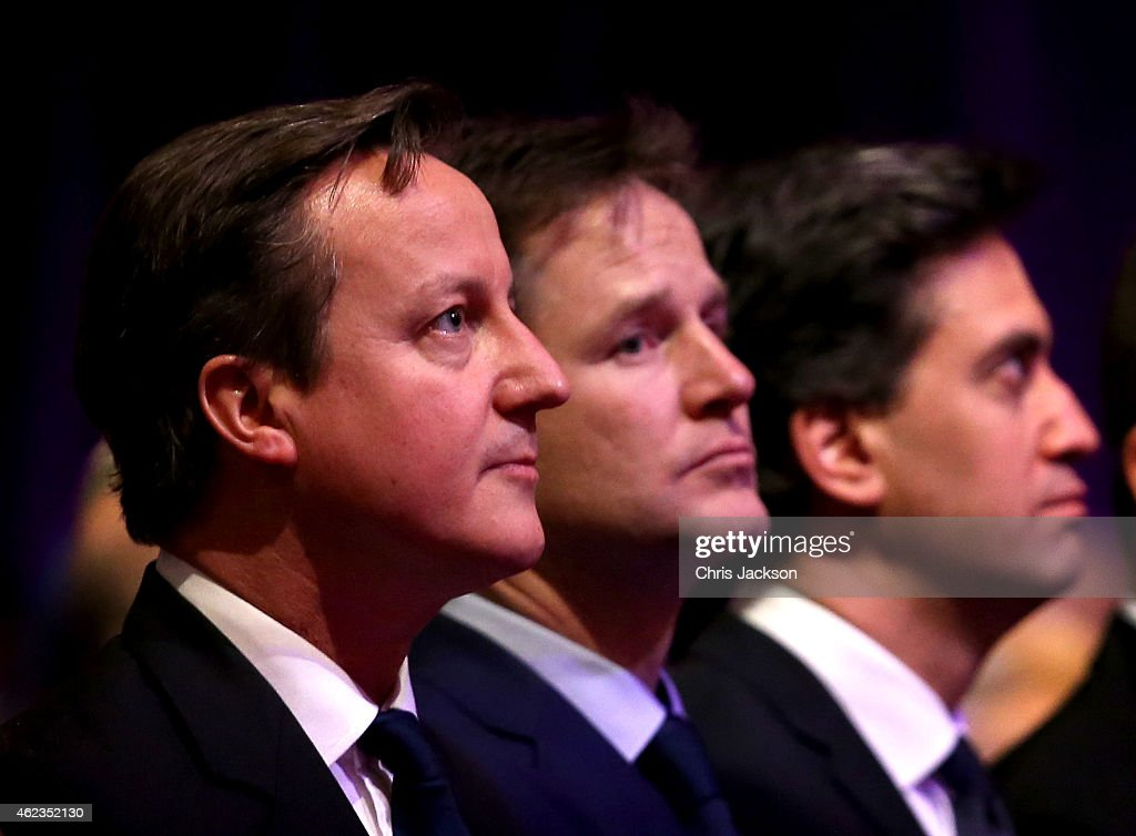 Prime Minister <a gi-track='captionPersonalityLinkClicked' href=/galleries/search?phrase=David+Cameron+-+Politician&family=editorial&specificpeople=227076 ng-click='$event.stopPropagation()'>David Cameron</a>, British Deputy Prime Minister <a gi-track='captionPersonalityLinkClicked' href=/galleries/search?phrase=Nick+Clegg&family=editorial&specificpeople=579276 ng-click='$event.stopPropagation()'>Nick Clegg</a> and Leader of the Labour Party, <a gi-track='captionPersonalityLinkClicked' href=/galleries/search?phrase=Ed+Miliband&family=editorial&specificpeople=4376337 ng-click='$event.stopPropagation()'>Ed Miliband</a> attend a Holocaust Memorial Day ceremony at Central Hall Westminster on January 27, 2015 in London, England.