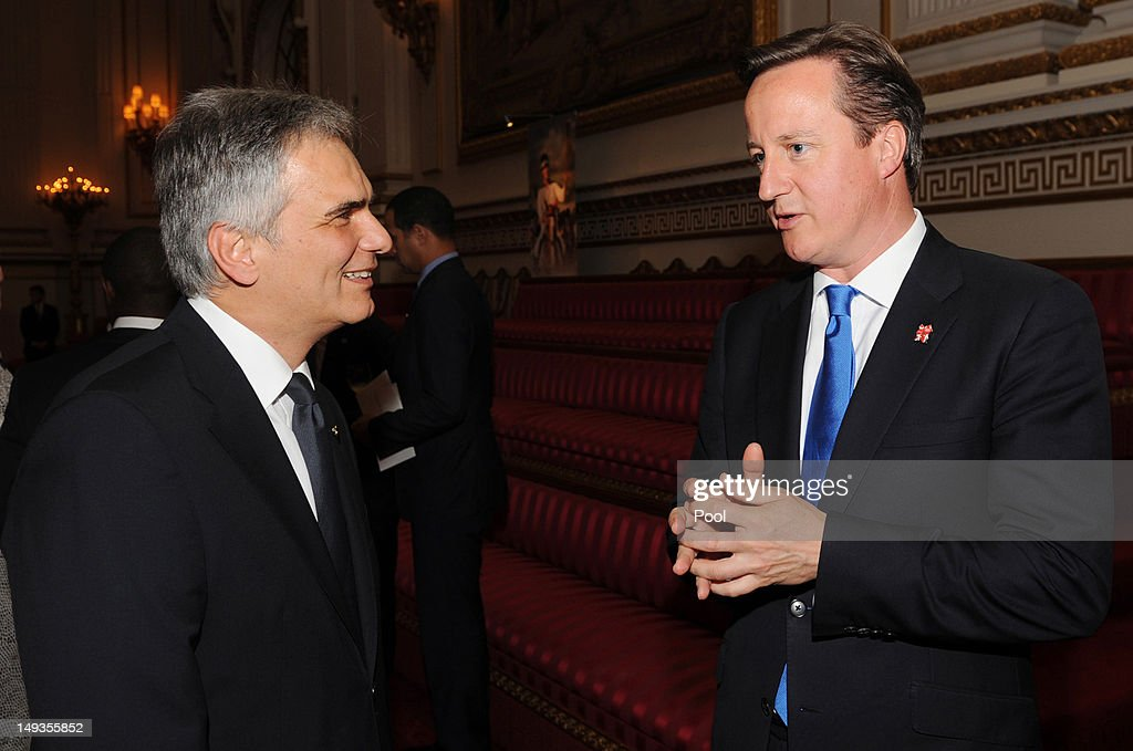 Prime Minister David Cameron chats with Austrian Chancellor Werner Faymann at a reception at Buckingham Palace for Heads of State and Government...