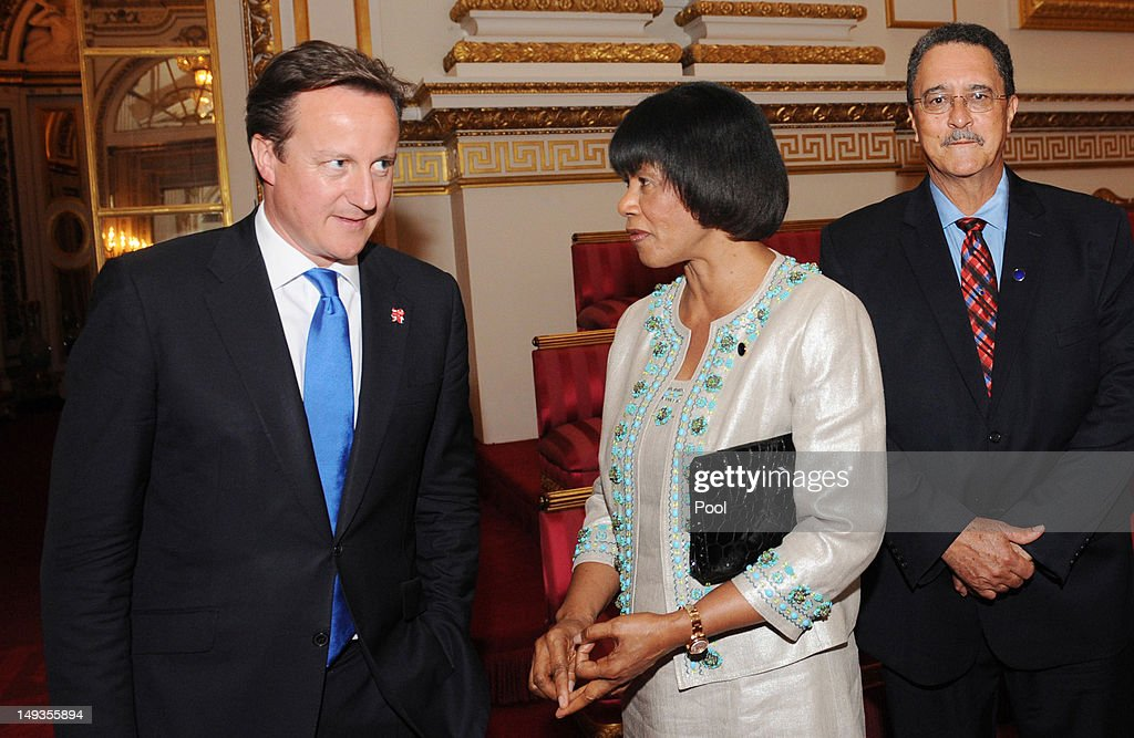 Prime Minister <a gi-track='captionPersonalityLinkClicked' href=/galleries/search?phrase=David+Cameron+-+Politician&family=editorial&specificpeople=227076 ng-click='$event.stopPropagation()'>David Cameron</a> chats with Prime Minister of Jamaica <a gi-track='captionPersonalityLinkClicked' href=/galleries/search?phrase=Portia+Simpson+Miller&family=editorial&specificpeople=4183773 ng-click='$event.stopPropagation()'>Portia Simpson Miller</a> as St Lucia Prime Minister Kenny Anthony looks on, at a reception at Buckingham Palace for Heads of State and Government attending the Olympics Opening Ceremony on July 27, 2012 in London, England.