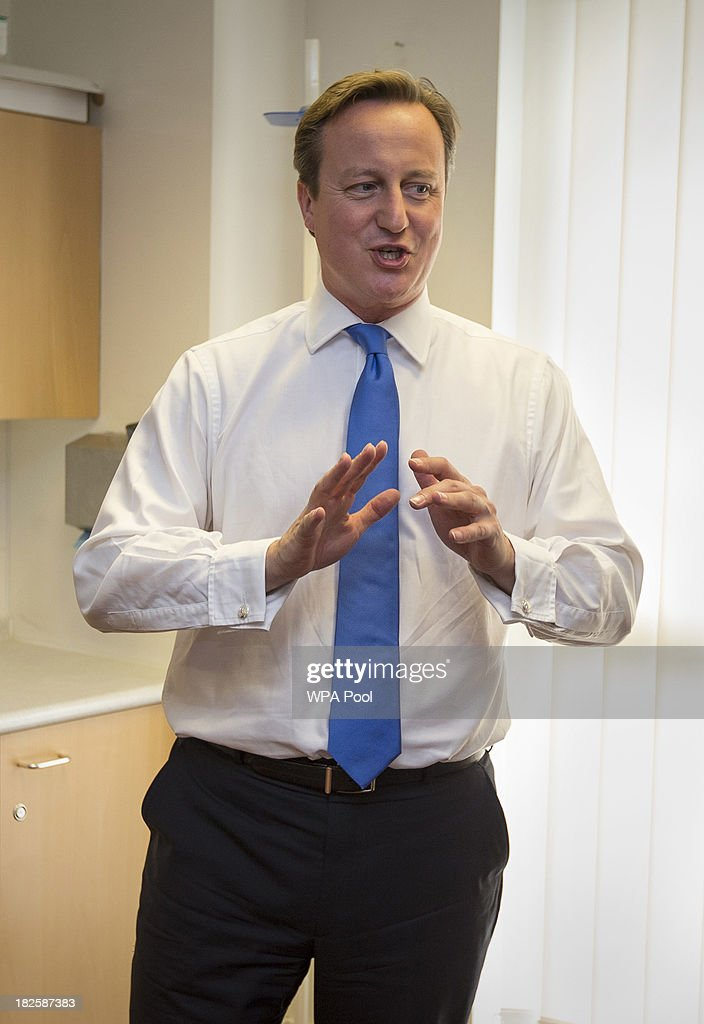 Prime Minister <a gi-track='captionPersonalityLinkClicked' href=/galleries/search?phrase=David+Cameron+-+Politician&family=editorial&specificpeople=227076 ng-click='$event.stopPropagation()'>David Cameron</a> declines the offer of a blood pressure test as he talks to Sister Julie Lees during a visit to the Range Medical Centre in Whalley Range ahead of the health debate at the Conservative Party Annual Conference on October 01, 2013 in Manchester, England.
