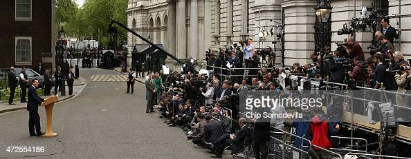 Prime Minister David Cameron delivers brief remarks to the news media in front of 10 Downing Street after returning from Buckingham Palace on May 8...