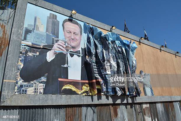 Prime Minister David Cameron features in an artwork by Peter Kennard and Cat Phillips as Banksy's Dismaland Bemusement Park opens to the public on...