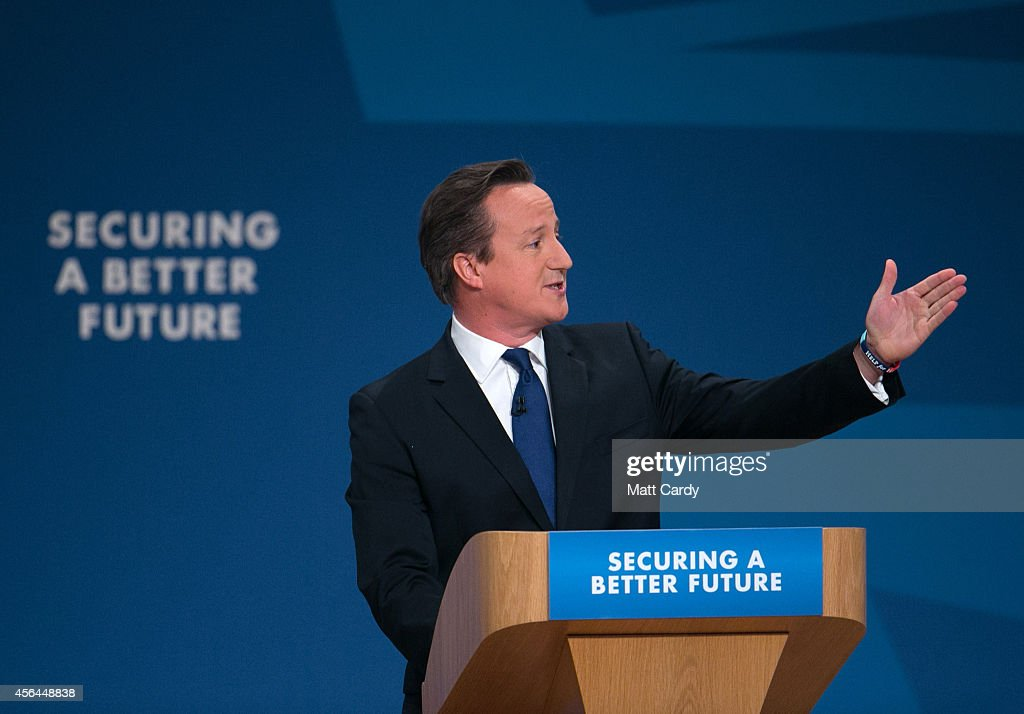 Prime Minister David Cameron gestures after giving his keynote speech to the Conservative party conference on October 1 2014 in Birmingham England...
