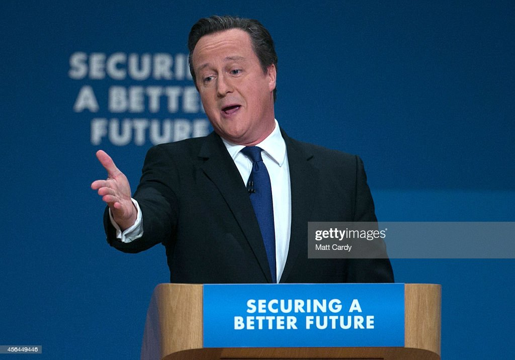 Prime Minister David Cameron gestures as he delivers his keynote speech to the Conservative party conference on October 1 2014 in Birmingham England...