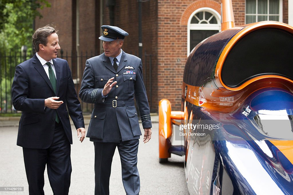 Prime Minister David Cameron greets British Royal Air Force Wing Commander Andy Green to view the Bloodhound Super Sonic Car at Downing Street on...