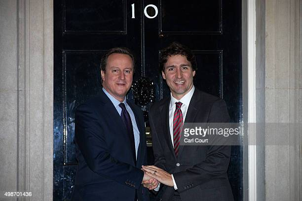 Prime Minister David Cameron greets Canada's Prime Minister Justin Trudeau at Downing Street on November 25 2015 in London England Prime Minister...