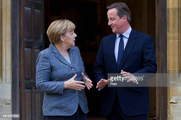 Prime Minister David Cameron greets German Chancellor Angela Merkel as he meets with her at Chequers the Prime Minister's country residence on...