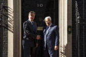 Prime Minister David Cameron greets Palestinian President Mahmoud Abbas to Downing Street on May 14 2014 in London England Mr Abbas is to meet US...