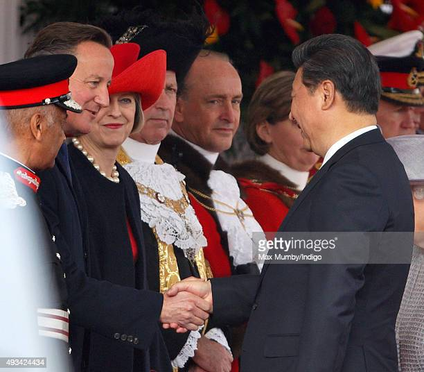 Prime Minister David Cameron greets President Xi Jinping during the Official Ceremonial Welcome for the Chinese State Visit on October 20 2015 in...